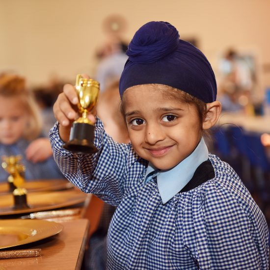 child holding a golden cup